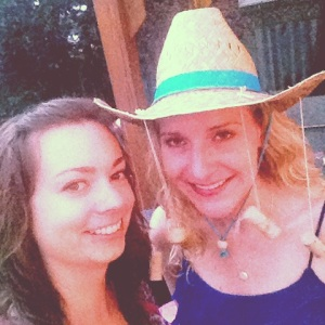 Nina and I at her goodbye party. And yes, she is wearing a hat with wine corks :)